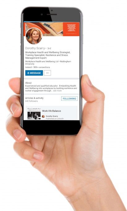 a persons hand holding a mobile phone with a linkedin profile showing on its screen